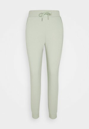 FIT - Tracksuit bottoms - green