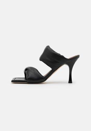 TWIST STRAP - Heeled mules - black