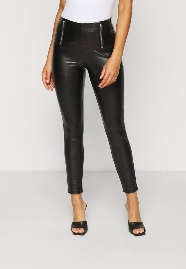 ONLTIA MIA  - Leggings - black