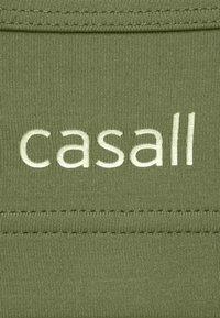 Casall - STRAPPY SPORTS BRA - Medium support sports bra - northern green - 2