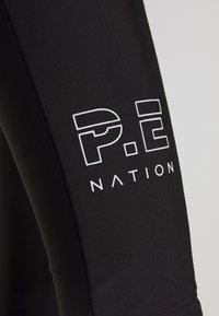 P.E Nation - ZONE IN - Legginsy - black - 5