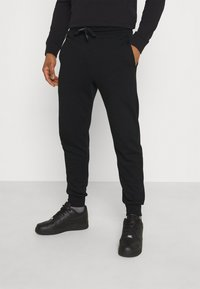 Diesel - PETER TROUSERS - Tracksuit bottoms - black - 0