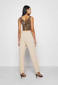 KENDALL + KYLIE - Tracksuit bottoms - beige - 2