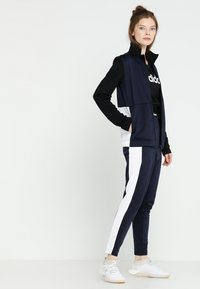 adidas Performance - ESSENTIALS SPORTS SLIM SHORT SLEEVE TEE - T-shirt print - black/white - 1