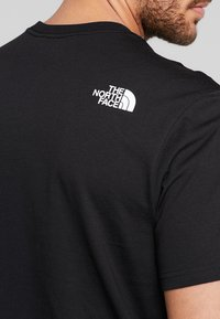 The North Face - NEVER STOP EXPLORING TEE - T-shirt med print - black - 3