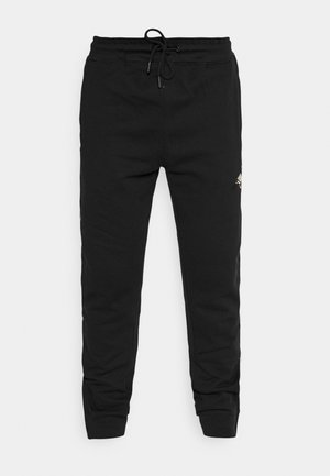PIPED PIGEON UNISEX - Tracksuit bottoms - black