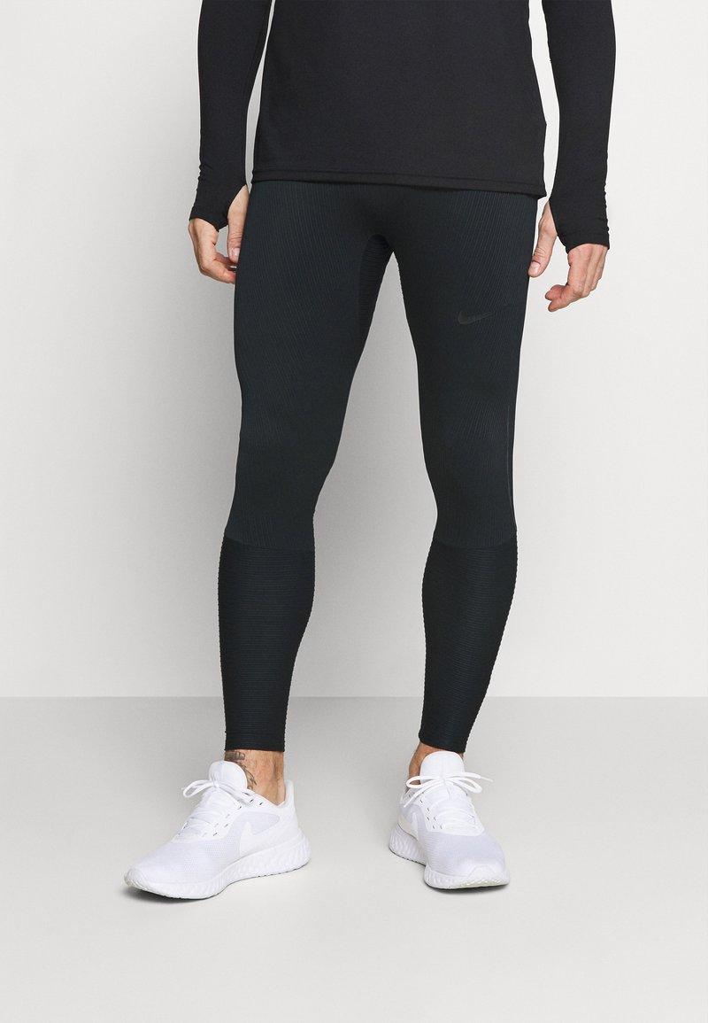 Nike Performance - SWIFT - Leggings - black