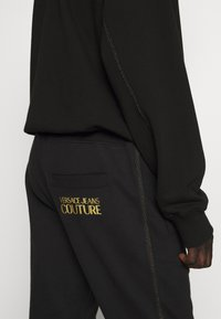 Versace Jeans Couture - BASIC JOGGERS - Tracksuit bottoms - black - 5