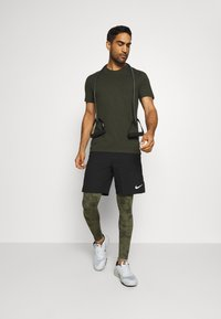 Nike Performance - DRY TEE CREW SOLID - Basic T-shirt - sequoia/black - 1