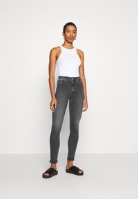 Calvin Klein Jeans - HIGH RISE SKINNY - Jeansy Skinny Fit - grey - 1