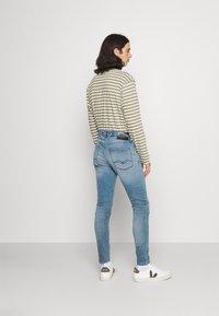 Replay - BRONNY X LITE - Slim fit jeans - medium blue - 2