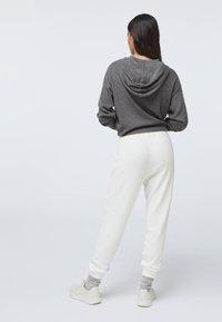 OYSHO - Tracksuit bottoms - white - 2