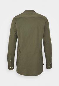Tommy Hilfiger - SLIM STRETCH SHIRT - Shirt - rocky mountain - 1