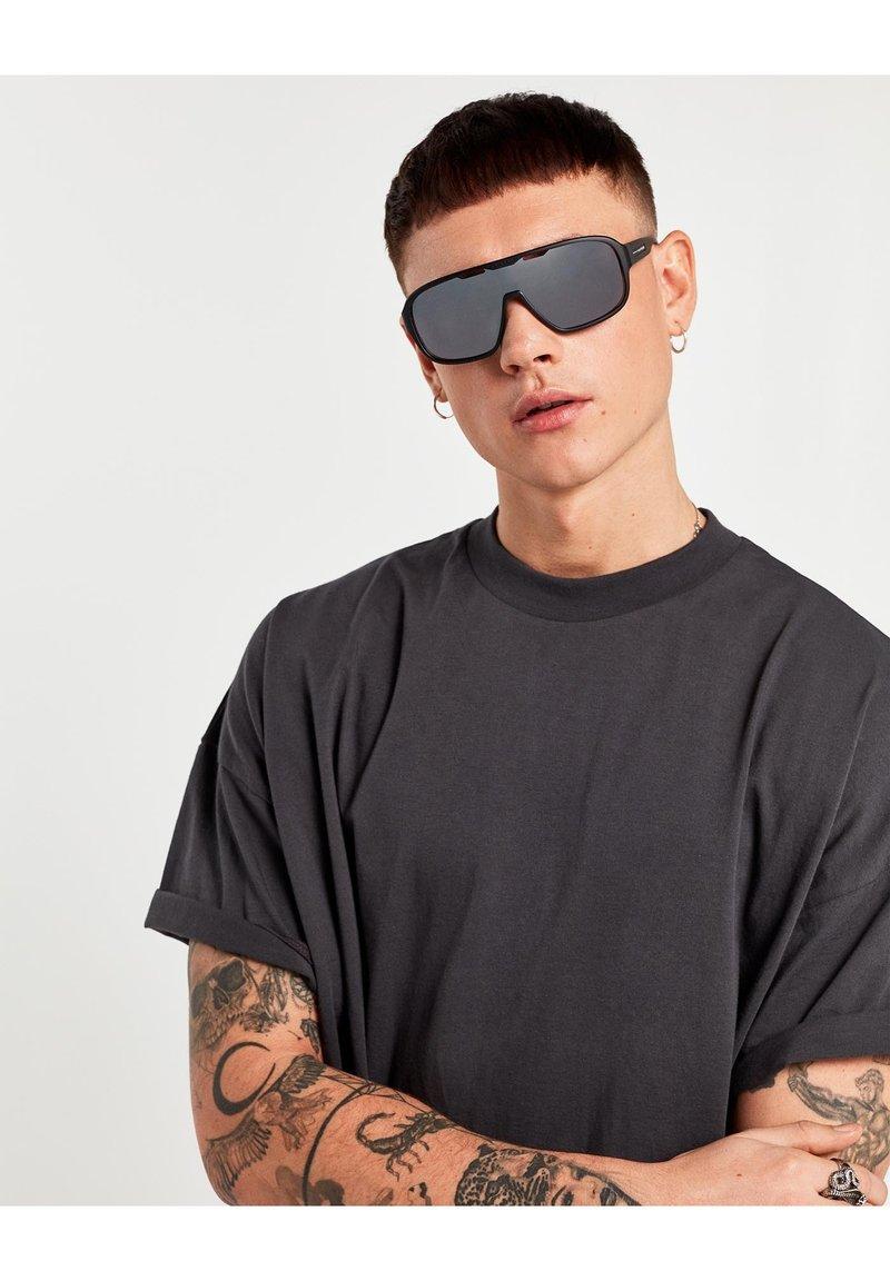 Hawkers - INFINITE - Sluneční brýle - black