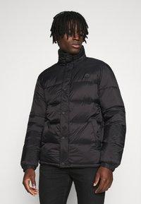 Redefined Rebel - PUFFER JACKET - Winter jacket - black solid - 0