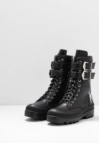 KARL LAGERFELD - TREKKA CUFF BUCKLE - Lace-up boots - black - 4
