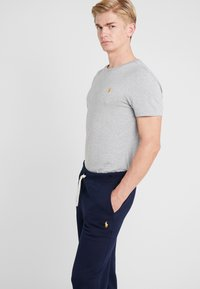 Polo Ralph Lauren - ATHLETIC  - Träningsbyxor - cruise navy - 3