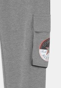 Converse - CHUCK PATCH UNISEX - Tracksuit bottoms - dark grey heather - 2