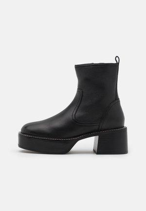 MONTERAL LOW PLATFORM BOOT - Platform ankle boots - black