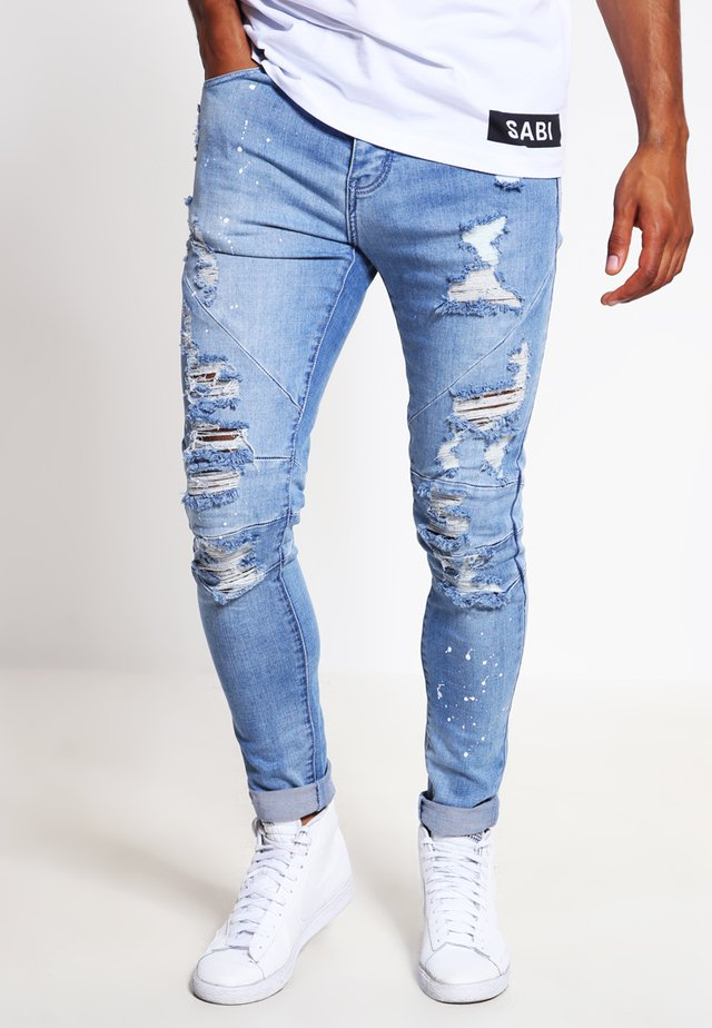 Jeans Tapered Fit - distressed light blue/white