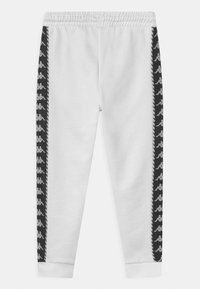 Kappa - INAMA UNISEX - Tracksuit bottoms - bright white - 1