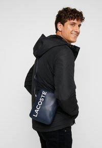 Lacoste - VERTICAL CAMERA BAG - Across body bag - dark sapphire - 1