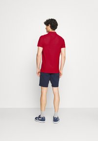 Tommy Hilfiger - CHEST STRIPE  - Polo shirt - primary red - 2