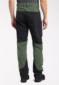 Haglöfs - Outdoor trousers - fjell green/true black - 1