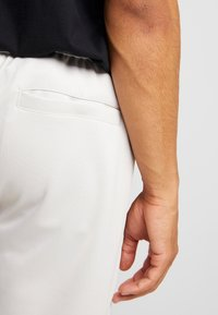 Nike Sportswear - PANT BODYMAP - Tracksuit bottoms - light bone/summit white/black - 3