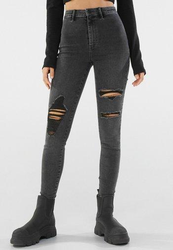 MIT RISSEN  - Jeans Skinny Fit - dark grey