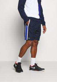 Lacoste Sport - SHORTS - Sports shorts - yav - 0