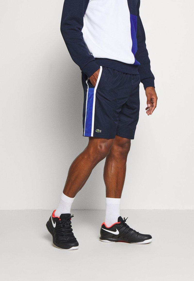 Lacoste Sport - SHORTS - Sports shorts - yav