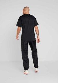 adidas Performance - CORE 18 RAIN PANT - Bukse - black/white - 2