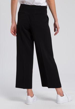CULOTTE - Trousers - black