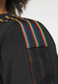 adidas Performance - TIRO PRIDE - T-shirt con stampa - black - 4