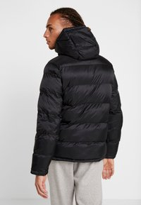 Champion - HOODED JACKET - Winter jacket - black - 2