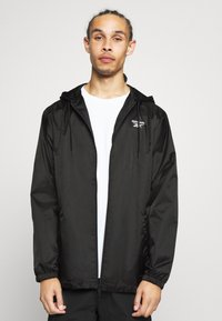 Reebok Classic - VECTOR WINDBREAKER - Summer jacket - black - 0