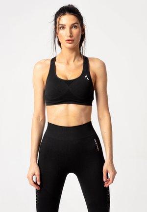 PHASE SEAMLESS - Sports bra - black