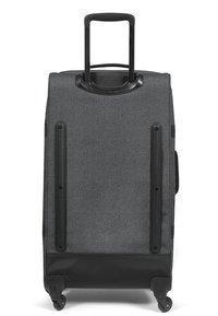 Eastpak - TRANS4 L CORE COLORS REISEGEPÄCK - Wheeled suitcase - black denim - 1