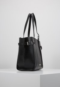 Calvin Klein - WINGED MED - Handbag - black - 3