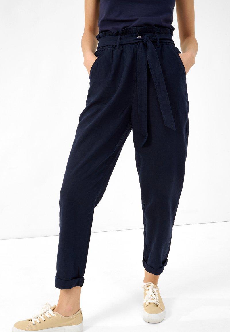 ORSAY - SLOUCHY - Trousers - nachtblau