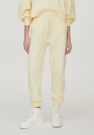 Tracksuit bottoms - mottled dark yellow