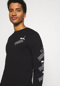 Puma - AMPLIFIED TEE - Long sleeved top - black - 3