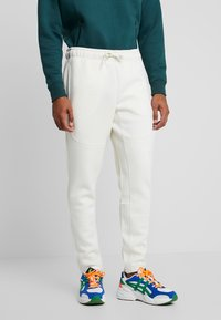 Urban Classics - CUT AND SEW PANTS - Tracksuit bottoms - sand - 0