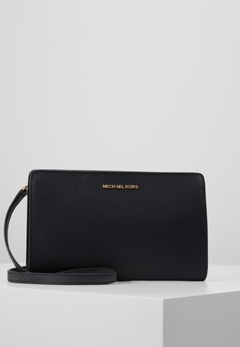 JET SET TRAVEL CROSSBODY CLUTCH