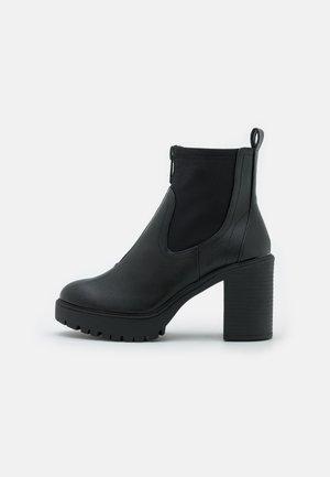 TRUFFLE - Platform ankle boots - black paris
