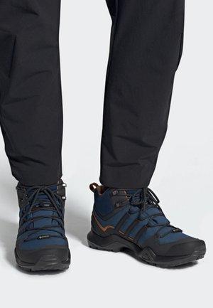 TERREX SWIFT R2 MID GTX SHOES - Sports shoes - blue