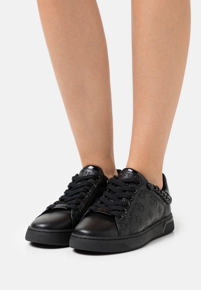 Guess - RIYAN - Trainers - black
