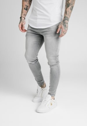 Vaqueros pitillo - washed grey