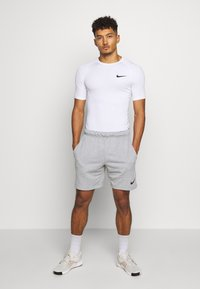 Nike Performance - Basic T-shirt - white - 1